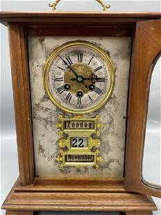 A Dutch wooden day and date clock