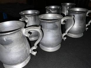 Six heavy pewter mugs