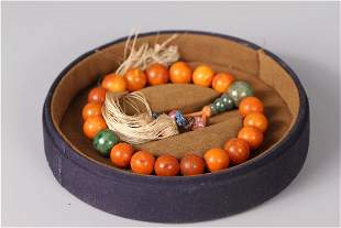A STRING OF HANDHELD 18 DRILLED WAED SEED BEADS