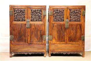 A PAIR OF HUANGHUALI WOOD OPENWORK BOOKCASES