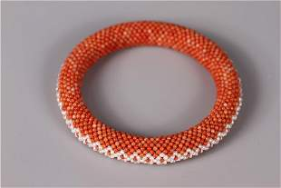 A RICE BEAD SHAPED CORAL BRACELET, QING DYN.