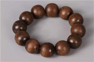 A STRING OF AGARWOOD BRACELET, QING DYN.