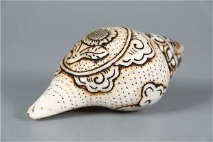 A CONCH SHAPED INSTRUMENT FOR BUDDHIST RITE
