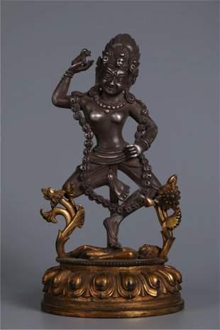 A GILT SILVER DAKANI BUDDHA STATUE