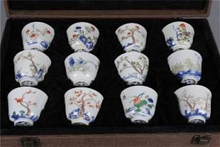 A SET OF TWELVE ROSE PORCELAIN DISPLAY CUPS