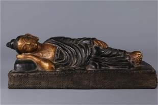 A WOODEN LYING SAKYAMUNI BUDDHA STATUE