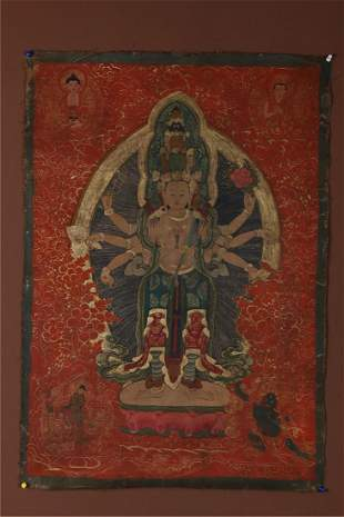 A EIGHT-ARM AND ELEVEN-FACE BUDDHA THANGKA.