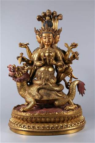 A GILT BRONZE SIX-ARM BUDDHA STATUE, MING DYN.
