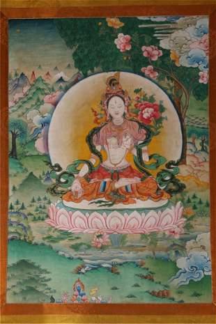 A SEVEN-EYE TARA BUDDHA THANGKA.
