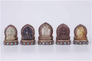 A SET OF FIVE CRYSTAL BUDDHA STATUES