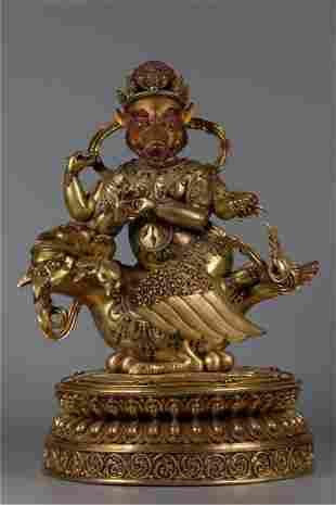 A GILT BRONZE MARICI BUDDHA STATUE