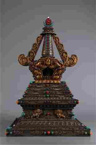 A SILVER BUDDHIST STUPA