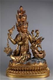 A GILT BRONZE NINE-FACE BUDDHA STATUE