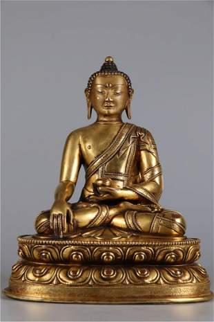 A GILT BRONZE BHAISAJYAGURU BUDDHA STATUE