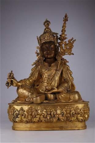 A GILT BRONZE PADMASAMBAWA BUDDHA STATUE
