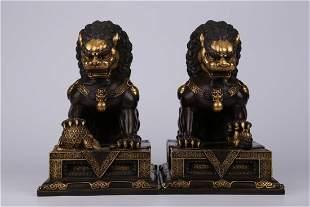 A PAIR OF GILT BRONZE LION ORNAMENTS