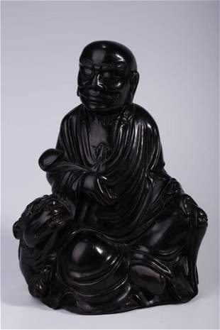 A NARRA WOOD CARVED STATUE