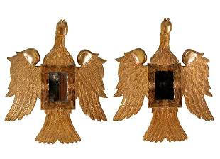 Pair of eagle sconces, nineteenth century. Carved and