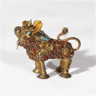 Foo's dog. Macala, Tibet s.XIX. In gilded brass, with
