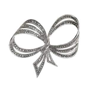 VIVIEN LEIGH.  Three-turn bow brooch, 1950s.  Silver
