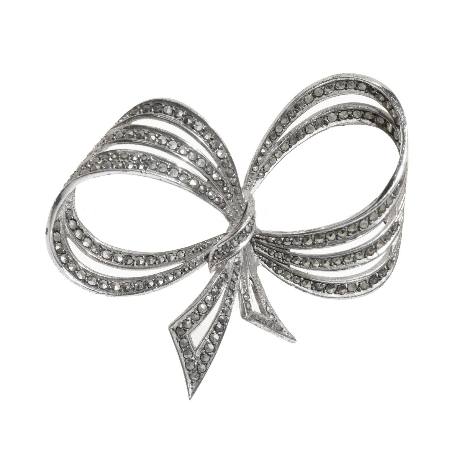 VIVIEN LEIGH. Three-turn bow brooch, 1950s. Silver