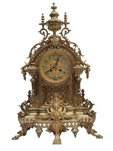 AN ANTIQUE FRENCH GILT BRONZE TABLE CLOCK