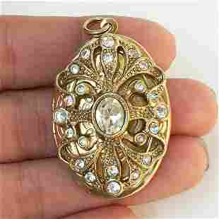 Gold tone clear crystals oval locket pendant