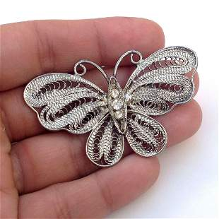 Vintage silver tone butterfly brooch with crystals