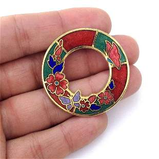 Vintage gold tone wreath brooch with red, green enamel