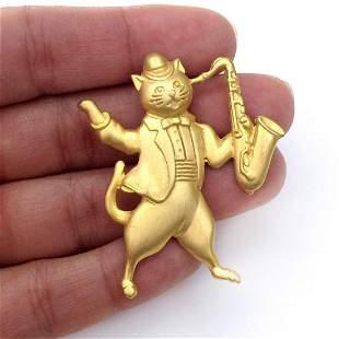 JJ Vintage gold tone Cat with Saxophone brooch, signed