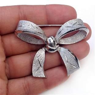 KRAMER Vintage silver tone Bow shape brooch, signed