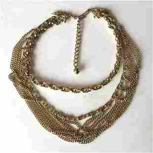 Gold tone multichain necklace with leaf design