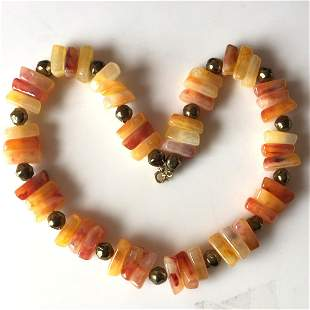 Gold tone and carnelian color beads necklace