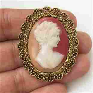 Gold tone woman's face Cameo oval brooch