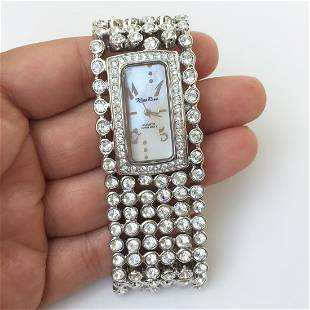 NINA RAYE: Silver tone MOP clear crystals watch