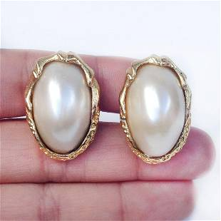 Vintage gold tone textured oval faux pearl ear clips