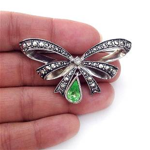 AVON Silver tone Bow shape brooch with crystal, signed