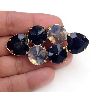 Gold tone brooch with prong set black and clear crystal