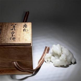 A CHINESE WHITE JADE PAPER-WEIGHT WITH THREE SHEEPS