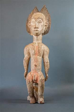 Punu statue whiteMale Seated statuette