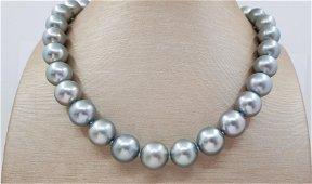 11.5x13.6mm Silvery Green Round Tahitian pearls