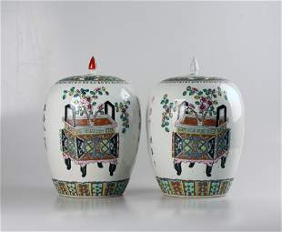 A pair of large jars with famille-rose designs, Qing