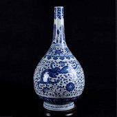 A blue and white porcelain vase with a dragon pattern