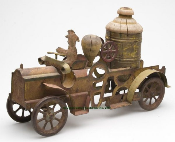 552: PAINTED TIN AND WOOD TOY FIRE ENGINE, probably ori