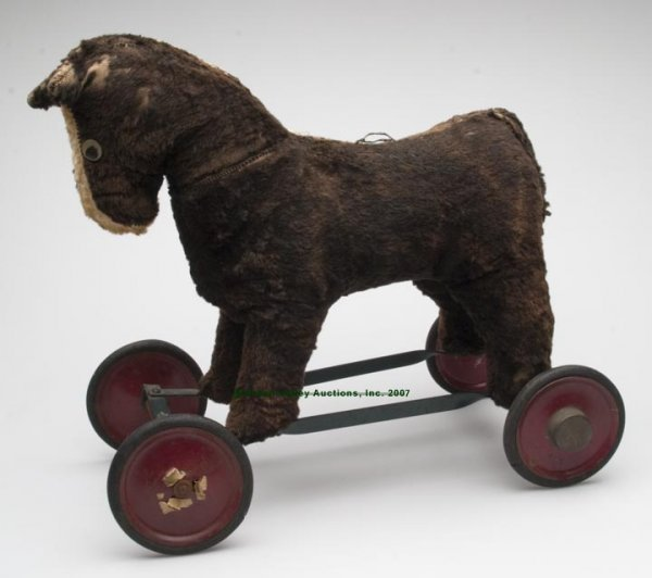 553: STRAW-STUFFED HORSE RIDING TOY, on a steel frame w