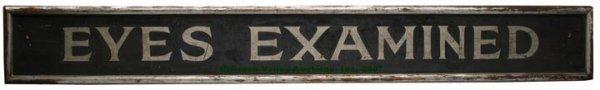 1088: AMERICAN PAINTED WOOD OPTOMETRY SIGN, black groun