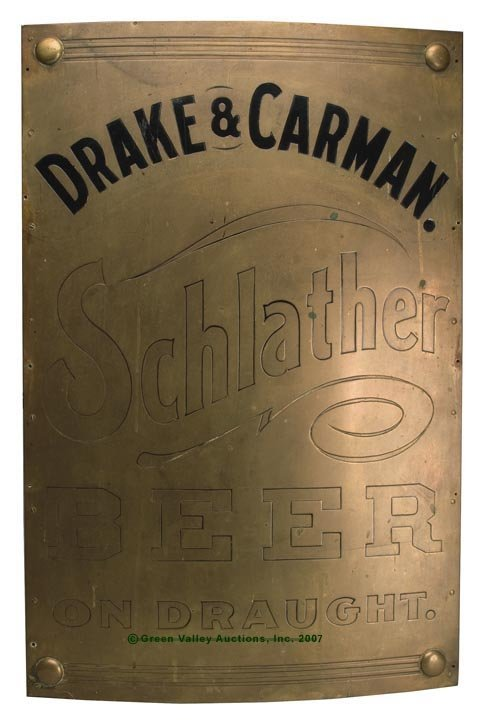 1096: ENAMELED BRASS ADVERTISING SIGN, bowed front atta
