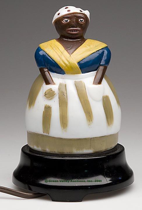 562: BLACK AMERICANA MAMMY ELECTRIC LAMP, opaque white/