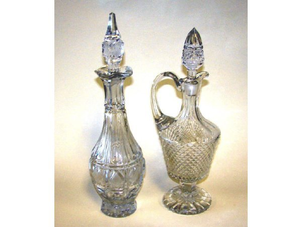 9: Group of 2 Crystal Decanters With Stoppers.
