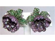 226: Ladies 18K WG, flower form earrings.